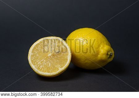 Lemons On A Black Background. Citrus Fruit. Healthy Food. Sliced Lemon. Sour Fruit