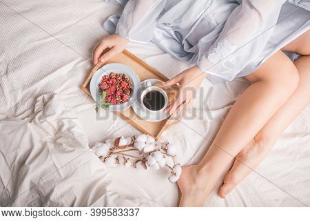 Man Bringing Woman Breakfast In Bed With Theater Tickets To Celebrate Wedding Anniversary. Breakfast