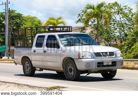 Tulum, Mexico - May 17, 2017: Pickup Truck Nissan Frontier D22 In The City Street.