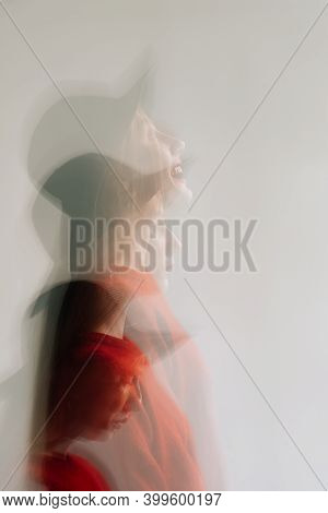 Defocused Female Portrait. Tranquility Mind. Personality Disorder. Silhouette Motion Blur Woman Sad