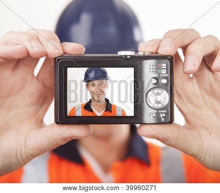 Carpenter taking self portrait with digital camera