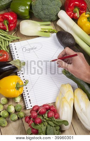 Hand writing list of organic vegetables