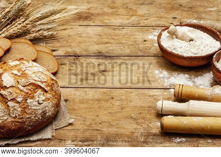 Fresh Bread With Wheat Ears And A Bowls Of Flour And Grain, Rolling Pins