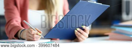 Close-up Of Concentrated Office Worker Working With Document. Young Woman Writing Information. Femal