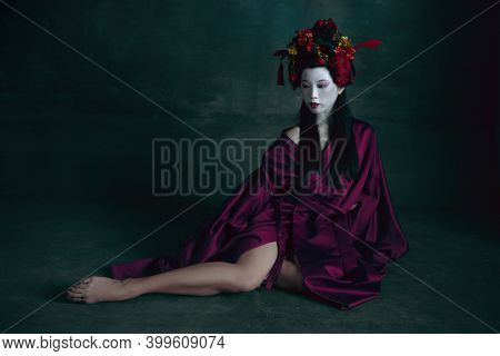 Beautiful. Young Japanese Woman As Geisha Isolated On Dark Green Background. Retro Style, Comparison
