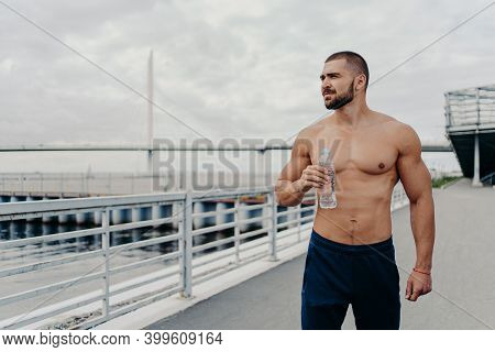 Handsome Bearded Sportsman Drinks Water From Bottle Promots Healthy Lifestyle And Concentrated Away