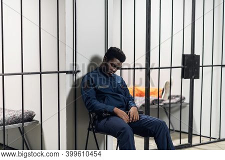 A Prison Warden Guards Cells With Prisoners Sentenced To Life In Orange Prison Uniforms