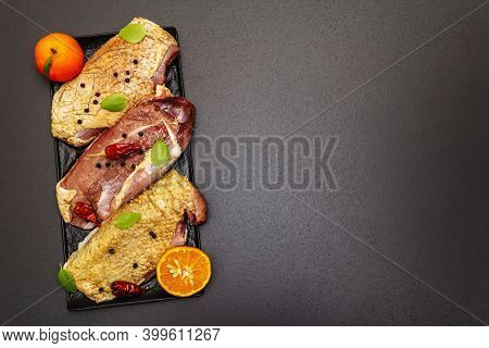 Raw Duck Breasts With Sea Salt, Fresh Basil, Tangerines And Spices