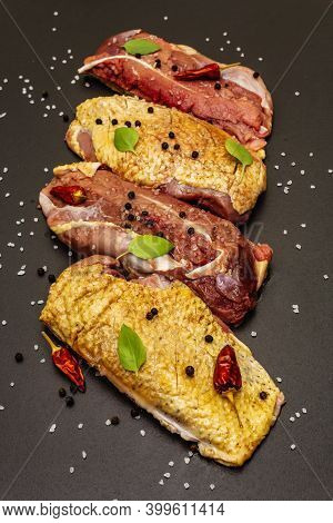 Raw Duck Breasts With Sea Salt, Fresh Basil, Chili And Spices
