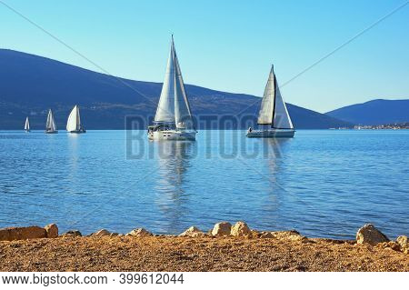 Winter Mediterranean Landscape With Sailing Boats On Water. Montenegro. View Of Bay Of Kotor Near Ti