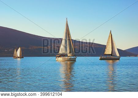 Winter Mediterranean Landscape With Sailing Boats On Water. Montenegro, Adriatic Sea. View Of Bay Of