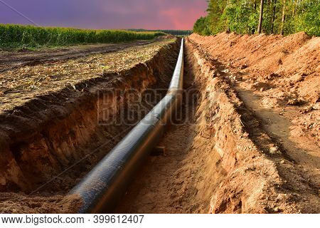 Construction Gas Pipeline Project On Amazing Sunset Background. Natural Gas And Crude Oil Transmissi