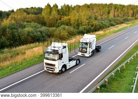 Heavy Recovery Truck Tows A Semitrailer Truck On Highway. Emergency Rescue Wrecker Tow Truck Coach H