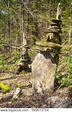 Rock Cairns On A Trail Within Humaston Brook State Park In Northfield Connecticut In Early Springtim