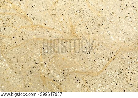 Wrinkled Airy Fabric With Gold Glitter On Beige Background. Abstract, Chic Holiday Flat Lay.