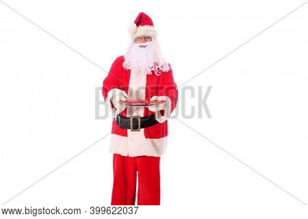 Santa Claus holds an empty plate. Santa holds a dinner or Cookie Plate. Isolated on white. Room for text. Santa Claus is ready for dinner. Merry Christmas. Happy Holidays.