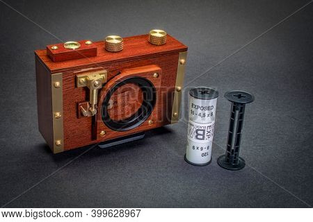 Fort Collins, CO, USA - December, 14, 2020: Retro wooden pinhole camera by Zero Image with a roll of the exposed black and white film film, alternative photography concept.