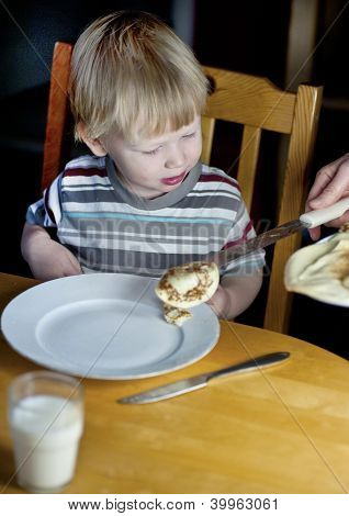 Young Boy Getting Some More Pancakes