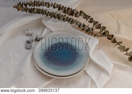 Set Of Ceramic Plates With Dried Flowers On Calico. Ceramic Tableware, Beautiful Arrangement.