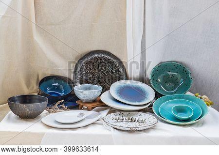 Different Ceramic Plates And Bowl On Calico. Ceramic Tableware, Beautiful Arrangement.