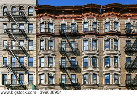View Of Old Apartment Buildings And Fire Escapes In New York City