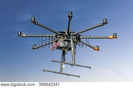 Big Black Homemade Eight Motor Hexacopter On Sky Background.