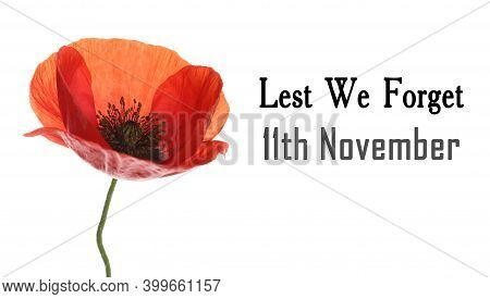 Remembrance Day Banner. Red Poppy Flower And Text Lest We Forget 11th November On White Background