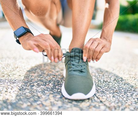 Close up of woman feet wearing training sneakers doing lace ready for running