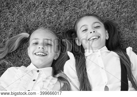 Happy Childhood Experience. Happy Children Relax On Green Grass. Enjoying Childhood Years. Childhood