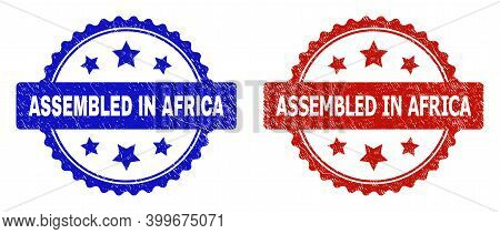 Rosette Assembled In Africa Seal Stamps. Flat Vector Distress Stamps With Assembled In Africa Captio