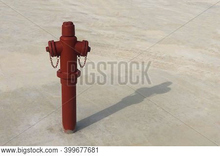 Red Fire Hydrant With Shadow On The Ground. Fireman Equipment