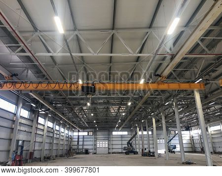 Overhead Crane Inside Industrial Building. Bridge Crane Inside Hangar