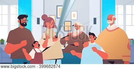 Multigenerational Family Using Selfie Stick And Taking Photo On Smartphone Camera Living Room Interi