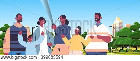 Multigenerational Family Using Selfie Stick And Taking Photo On Smartphone Camera African American P