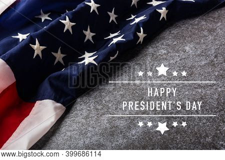 "United States National Holidays. American Or Usa Flag With ""happy President's Day"" Text On Cement Ba"