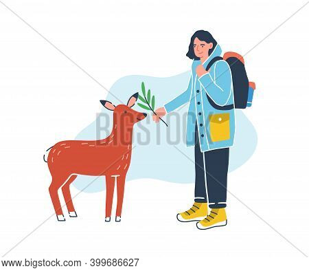 Female Traveler With Touristic Backpack Feeding Cute Deer At Petting Zoo. Young Backpacker With Anim