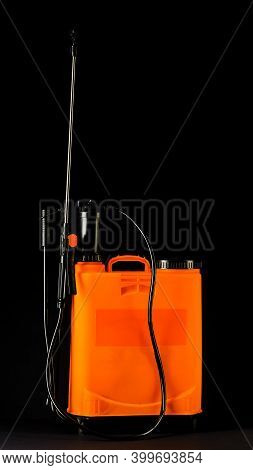 Pesticide Sprayers On An Isolated Black Background. To Work In The Garden And The Vegetable Garden.