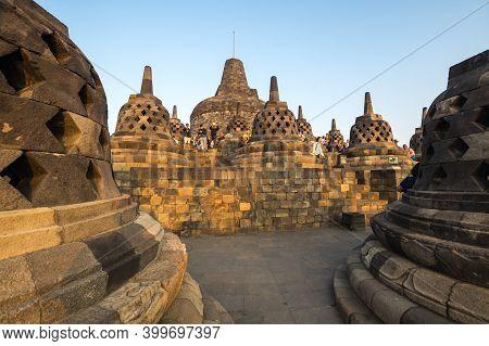 Java, Indonesia - 09 September 2018: Tourists Watching Sunrise At Borobudur, A 9th-century Mahayana