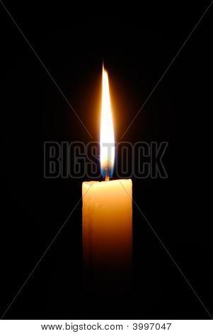 Burning Candle Isolated On Black Background