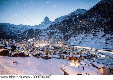 snowing in Zermatt traditional Swiss ski resort under the Matterhorn
