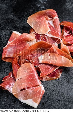 Spanish Jamon Serrano, Ham. Black Background, Top View