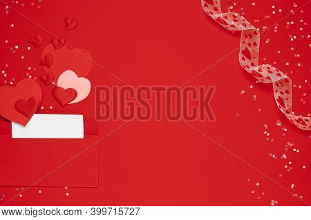 Red Envelope With Love Letter On Red Background With Many Hearts Around. Hearts Pours Out Of The Env