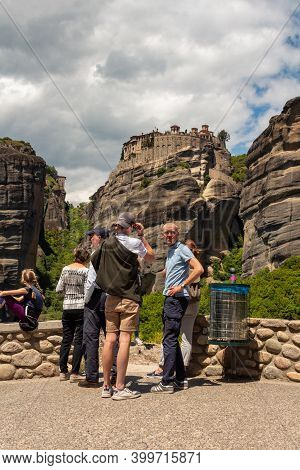 Kalambaka, Greece - May 02, 2019: Tourists And The Monastery Of Great Meteoron At The Background, Me