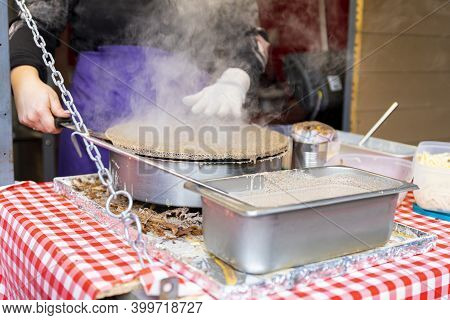 Making Pancakes At The Fast Food Restaurant Outdoors In The Street