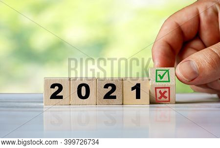 The Hand Turns The Wooden Cube And Change The Word 2021 With Green Positive Tick Check Box And Red R