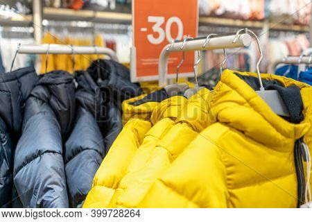 Row Of Winter Gray And Yellow Jackets, 30 Percent Discount