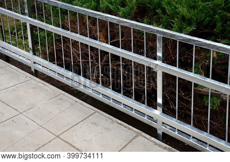 Railing With Two Handrails. Made Of Galvanized Steel Prisms. The Lower Railing Is A Protection Again