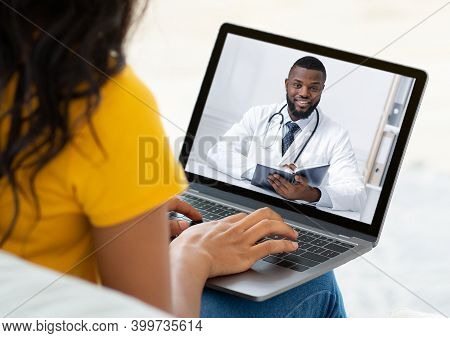 Ehealth Concept. Unrecognizable Woman Having Online Video Conference With Doctor On Webcam, Using La