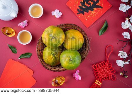 Top View Of Fresh Tangerine Mandarin Orange On Red Background For Chinese Lunar New Year.