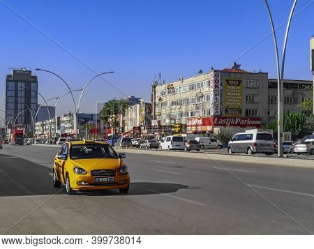 Turkey, Ankara - October 24, 2019: Yellow Taxi Car On Blurred Cityscape Background At Fatih Cd Stree